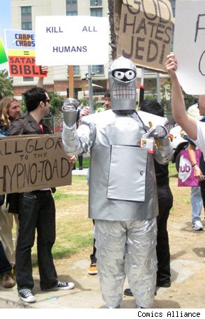 man in robot costume with KILL ALL HUMANS sign