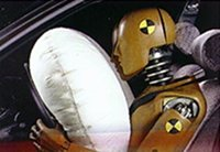 Test dummy and airbag