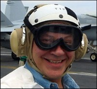 Tancredo in flight helmet and goggles