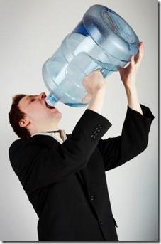 A-man-enjoys-water-cooler-water