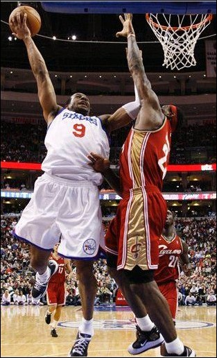 Philadelphia 76ers' Andre Iguodala, left, goes up for a shot as Cleveland Cavaliers' LeBron James defends in the second half of an NBA basketball game, Friday, March 12, 2010, in Philadelphia. Cleveland won 100-95. (AP Photo/Matt Slocum)