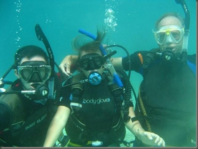 Stan, Emma and Steve pose underwater