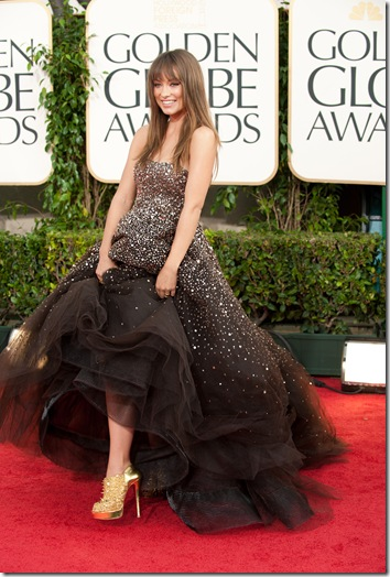 2011 Olivia Wilde attends the 68th Annual Golden Globes Awards at the Beverly Hilton in Beverly Hills, CA on Sunday, January 16, 2011. ++ FASHION TAGS ++ Olivia Wilde: Marchesa gown black tulle with antique gold sequin strapless bodice, Christian Louboutin heels
