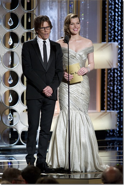 Kevin Bacon (left) and Milla Jovovich present at the 68th Annual Golden Globe Awards at the Beverly Hilton in Beverly Hills, CA on Sunday, January 16, 2011. ++ FASHION TAGS ++ Milla Jovovich: Armani prive silver sea foam chiffon gown matching Ferragamo heels and all vintage jewelry: 18-19th hundred. Sent via BlackBerry from Cingular Wireless