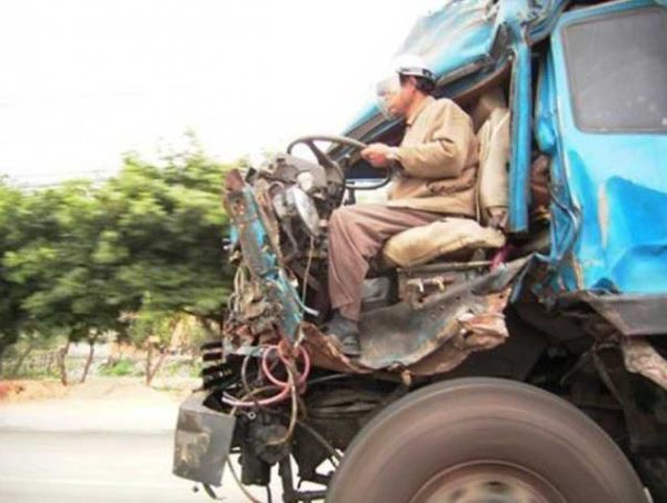 Photos that need no words to laugh - Accident truck driver with helmet