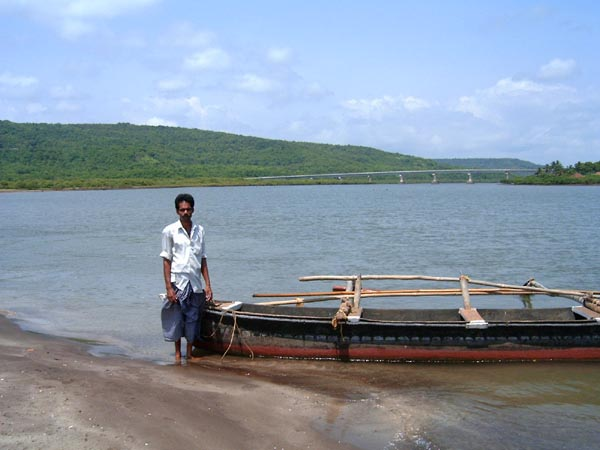Boatman and his boat at Harne beach