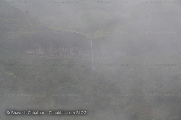 Dense mist due to monsoon clouds in Tamhini ghat waterfall