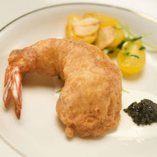 Buttermilk Battered Shrimp with California Sturgeon Caviar and Creme Fraiche Over Pea Sprout and Tomato Salad
