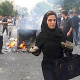 In this photograph posted on the internet, an Iranian woman carries rocks at an anti-government protest in Tehran, Iran Saturday June 20, 2009. (AP Photo)