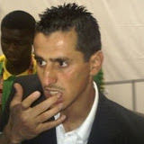 Algeria striker Rafik Saifi wipes h!  is mouth in the mixed zone at Loftus Versfeld in Pretoria, South Africa, after the Algeria against United States in a World Cup soccer match Wednesday June 23, 2010. Saifi has been involved in an altercation with a journalist after his team was eliminated from the World Cup. The incident following Wednesday's 1-0 loss to the United States happened at Loftus Versfeld. A female reporter from an Algerian publication was heard shouting at Saifi, who left the stadium holding his lip and refusing to respond to questions. (AP Photo/Rob Harris)?????????????????????????????????????????????????????????????????????????????????????????????????????