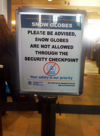 Airport Sign: Please be advised, Snow Globes are not allowed through the security checkpoint