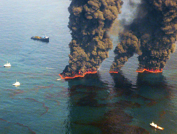 Controlled burns are conducted in the Gulf of Mexico in an effort to burn off some of the oil in the water, 19 May 2010. John Kepsimelis / U.S. Coast Guard via Reuters