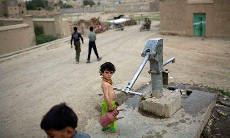 A girl at a communal water pump in Kabul, Afghanistan. More than half the shallow wells people use will dry up if temperatures continue to rise as predicted. Photograph: Rodrigo Abd / AP