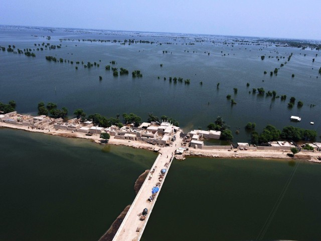An area of land surrounded by flood water is pictured from a rescue helicopter operated by the Pakistani army near Dadu, Sindh province, Pakistan, 2010. Photo: AFP