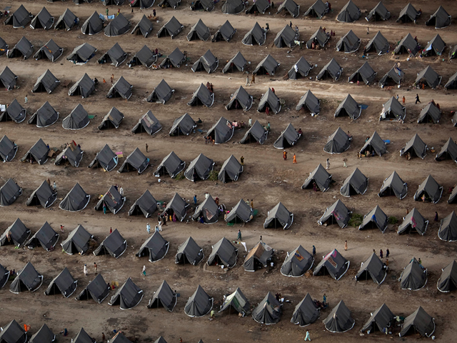 Tents lined up with military precision by the Pakistan army for thousands displaced by monsoon floods in Sukkar, Pakistan, 26 August 2010. Kevin Frayer / guardian.co.uk