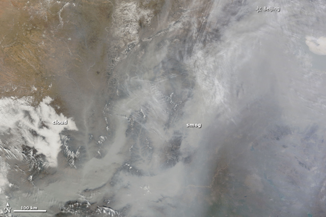 Dense smog settled over the North China Plain on February 20, 2011. The featureless gray-brown haze is so thick that the ground is not visible in parts of this photo-like image taken at 11:35 a.m. by the Moderate Resolution Imaging Spectroradiometer (MODIS) on NASA's Terra satellite. At that time, a weather station at Beijing's airport reported visibility of 1.9 miles (3.1 kilometers). Visibility dropped as low as 1.1 miles (1.8 km) later in the afternoon. NASA / Jeff Schmaltz / MODIS Rapid Response Team