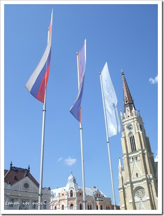 Crkva imena Marijinog with flags of Serbia, Vojvodina and Novi Sad