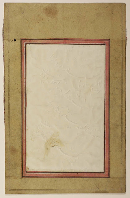 "This calligraphic fragment is unique in the collections of the Library of Congress, as it uses no ink at all. Instead, the text is executed in a style known as ""fingernail calligraphy"" (khatt-i nakhani), in which either a nail or a metal stylus is used to create topographical impressions on a monochromatic (usually white) sheet of paper. Possibly linked to the rise of lithography and the printing press, this Qajar practice discards the traditional tools of the reed pen and ink in favor of a more abstract and experimental approach towards calligraphy."