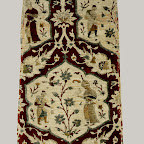 Textiles of the Safavid period demonstrate the technical mastery of the weavers as well as their strong dependence upon book illustration and illumination as a pattern source, at least in the products of court workshops. This example features a lattice pattern formed by staggered rows of lobed medallions. The princely pastime of falconry is the subject of the medallion scenes: the bird sits on her master's gloved hand while an attendant, holding a receptacle and a bag for the game, approaches. A duck flies away from the falconer. The background of these scenes was once covered with metal thread, now mostly worn