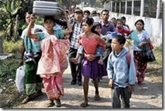 Villagers leave with their baggage after ethnic clashes between Garo and Rabha tribals in Meghalaya