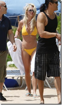Britney Spears was in a yellow string bikini in Hawaii today. The pop star was all smiles as she enjoyed a little beach time with her boyfriend Jason Trawick._P_Pictured_ Britney Spears_B_Ref_ SPL204742  240810  __B__BR__Picture by_ Derek Shook _ Splash News_BR____P__P__B_Splash News and Pictures__B__BR__Los Angeles_310_821_2666_BR__New York_212_619_2666_BR__London_870_934_2666_BR__photodesk_splashnews.com_BR____P_