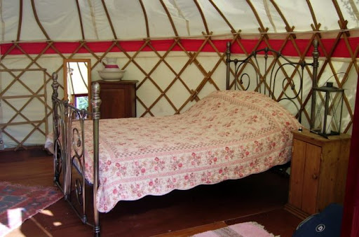 Four poster bed in yurt