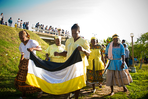Parade lead by Garifuna women; Banquitas, Orange Walk Town.