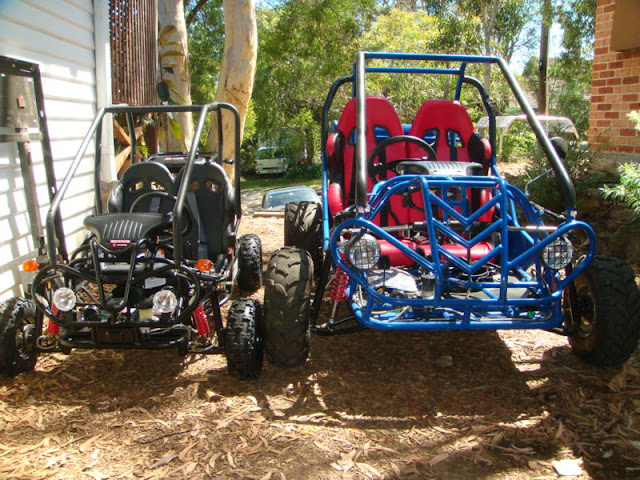 150cc Baja next to 110cc kids buggy Front