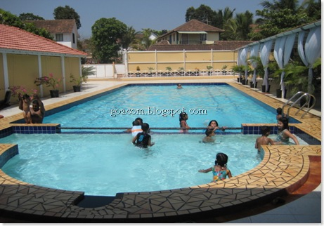 Goan families enjoying a swimming pool