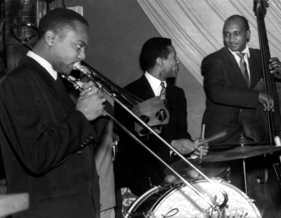 BNote_ Oscar Pettiford with Max Roach and J.J. Johnson (Photo by Marcel Fleiss).jpg