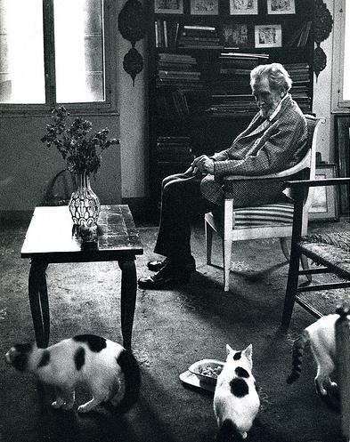 Ezra Pound with his three cats (also tried for high treason after the war).jpg