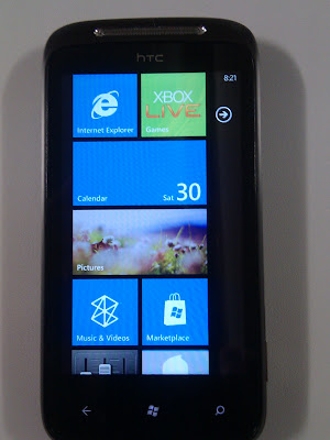 Windows Phone 7 tile interface showing the Calendar and Pictures Hub's