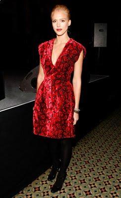 Jessica Alba wore her signature black leggings with a Prada red velvet floral dressr