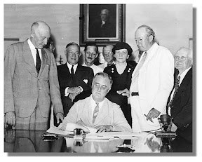 FDR signs the Social Security Act