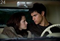 KRISTEN STEWART and TAYLOR LAUTNER star in THE TWILIGHT SAGA: NEW MOON.