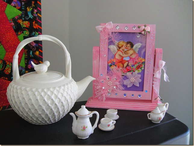 bird nest tea pot and pink frame