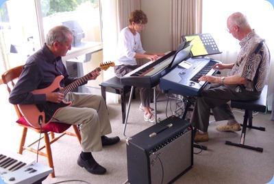 Brian Gunson (guitar), Denise Gunson (piano) and Peter Brophy on keyboard jamming
