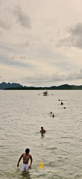People Coming Ashore from a Boat in Coron, Palawan