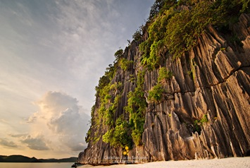 The Lighted Limestone Cliffs at Coron's Banol Beach