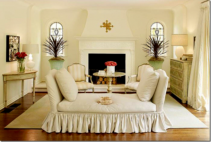 a simply furnished living room the fireplace is the focal point and all is placed around it symmetrically balanced living room
