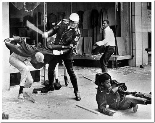 A police officer uses his nightstick on a youth reportedly involved in the looting that followed the breakup of a march led by Dr. Martin Luther King Jr. March 28, 1968, in Memphis, Tenn. Black leaders accused the police of brutality while police officers said they did what was necessary to restore order. In the wake of the violence, a curfew was imposed and more than 3,800 National Guardsmen were rushed to the city. A week later, King was assassinated at Memphis' Lorraine Motel. (AP Photo/Jack Thornell)