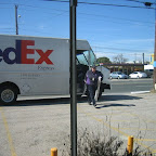 Midday, the FedEx gal comes to bring more goodies!