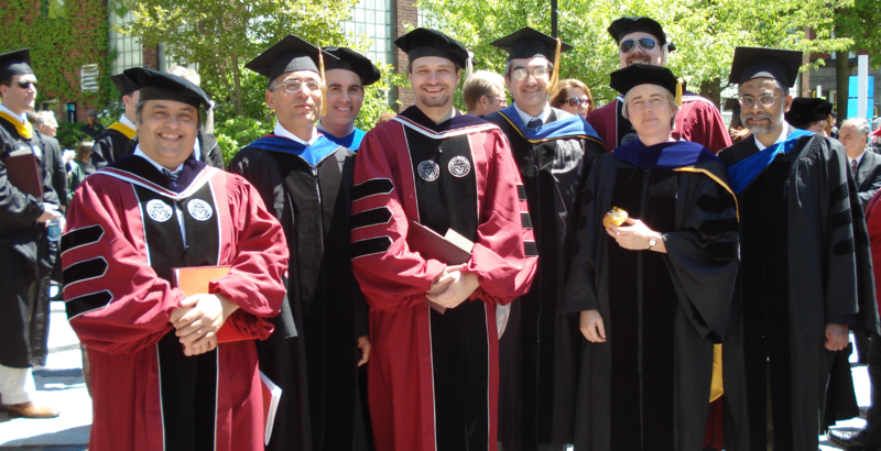 a group of people in academic regalia, with similar stripes on the sleeves