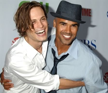Criminal Minds' Shemar Moore and Matthew Gray Gubler grinning with their arms around each other. Also, Shemar Moore is wearing a really kick-ass hat.