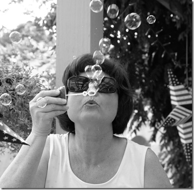 Cropped Mary blowing bubbles