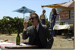 Alan Rickman takes a sip.