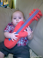 Hugo, Guitar Hero.  He knew instinctively how to hold it.