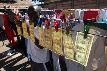 APTOPIX Zimbabwe Money Laundering