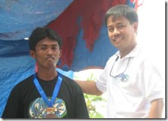 Mr. Abdul receives his medal for outstanding trainee from PDAP Executive Director Jerry E. Pacturan during the ceremony held last April 23, 2008