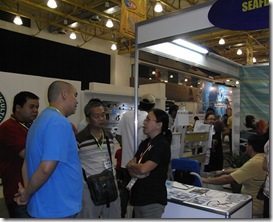 Dr. MLC Aralar (rightmost) giving consultations to guests at the AQD booth